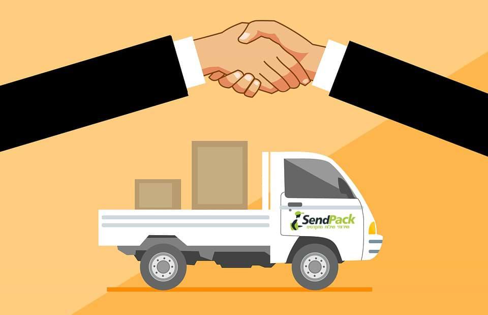 משאית שליחויות ולחיצת יד עסקית